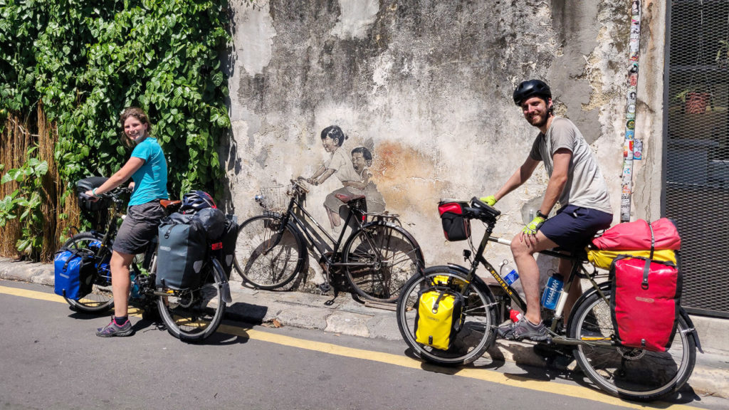 "Johanna & Armand at ""Children on Bicycle"" mural street art, Lebuh Armenian, George Town, Penang"