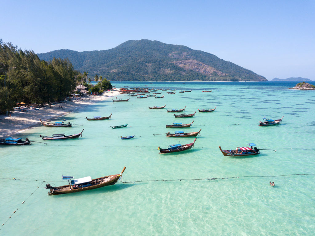 Long-tail boats at Sunrise Beach, Koh Lipe & Koh Adang in the background