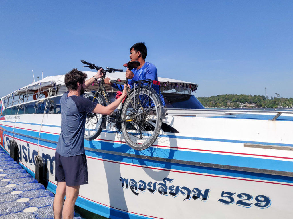 Armand loading the bikes on the speedboat from Koh Lipe to Pak Bara