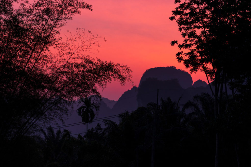 Sunrise over Khao Sok National Park seen from Khlong Phanom