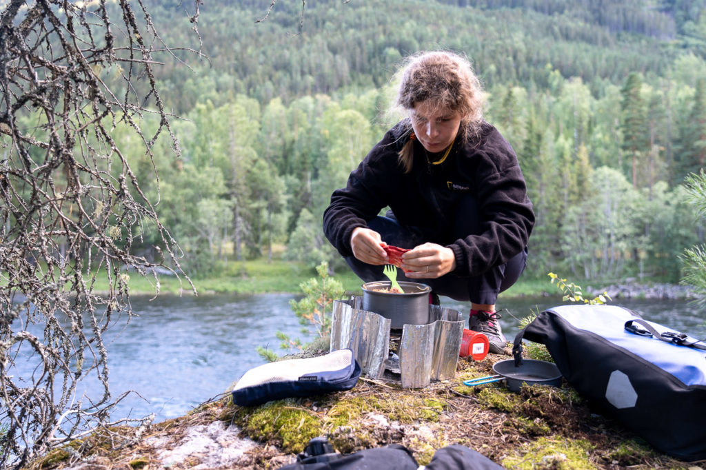 Johanna cooking at our wild camping spot nearby Stavn, Flå