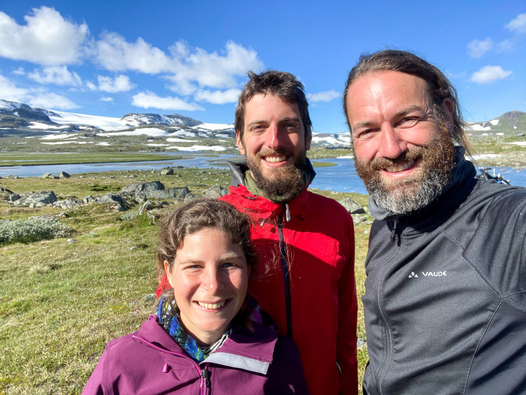 Johanna, Armand & Anam nearby Finse & Hardangerjøkulen in the background