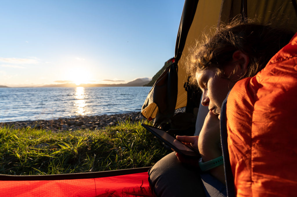 Johanna at our wild camping spot along the Sognefjorden nearby Leirvik