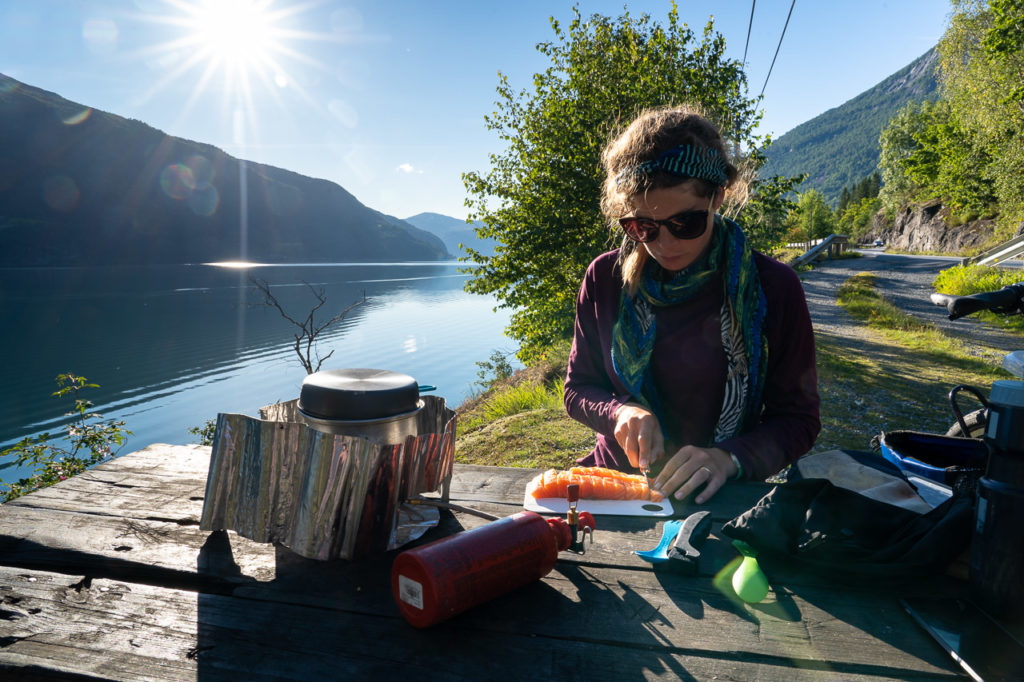 Johanna cooking salmon at our wild camping spot along the Innvikfjorden