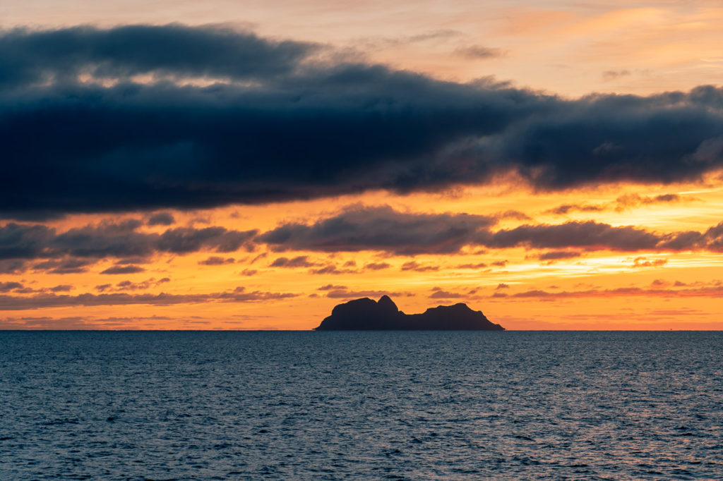 Sunset over Mosken island seen from the ferry Bodø-Moskenes